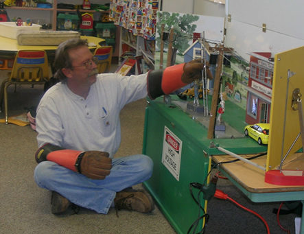 Lineworker performing safety demonstration in classroom